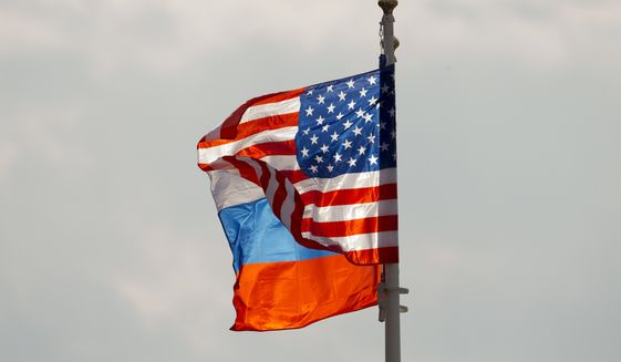 U.S. and Russian national flags wave on the wind before U.S. Secretary of State Rex Tillerson arrival in Moscow's Vnukovo airport, Russia, Tuesday, April 11, 2017. Mr. Tillerson is due to meet with Russian Foreign Minister Sergey Lavrov on Wednesday. (AP Photo/ Ivan Sekretarev)