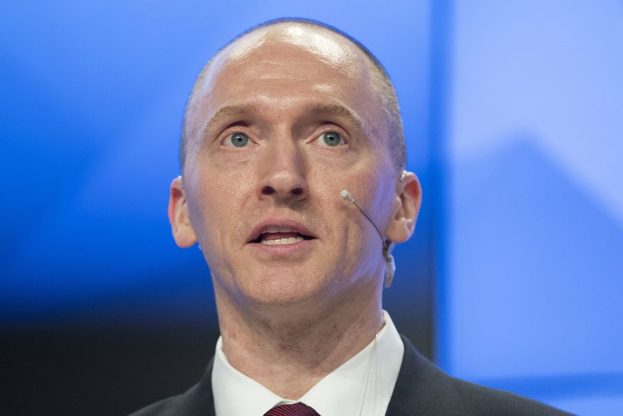 FILE - In this Dec. 12, 2016, file photo, Carter Page, a formerforeign policy adviser of U.S. President-elect Donald Trump, speaks ata news conferenceat RIA Novosti news agency in Moscow, Russia. A published report says the FBI obtained a court order to monitor communications of an adviser to then-candidate Donald Trump last summer. The Washington Post reported April 11, 2017 the application to a special court to monitor Carter Page was part of the investigation into potential links between the Republicans presidential campaign and Russia. The newspaper said its report was based on unnamed law enforcement and other U.S. officials. (AP Photo/Pavel Golovkin, file)