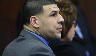 Defendant Aaron Hernandez listens as Judge Jeffrey Locke addresses the jury's question during his double murder trial at Suffolk Superior Court, Tuesday, April 11, 2017, in Boston. Hernandez is on trial for the July 2012 killings of Daniel de Abreu and Safiro Furtado who he encountered in a Boston nightclub. The former New England Patriots NFL player is already serving a life sentence in the 2013 killing of semi-professional football player Odin Lloyd. (AP Photo/Elise Amendola, Pool)