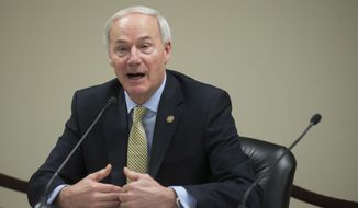 FILE- In this Jan. 4, 2017, file photo Arkansas Gov. Asa Hutchinson speaks to members of the press during a Q&A session in Little Rock, Ark. The American Bar Association President Linda Klein urged Gov. Asa Hutchinson in a letter dated Tuesday, April 11, to modify the state's schedule for putting the inmates to death to allow for adequate time between executions. (AP Photo/Brian Chilson, File)