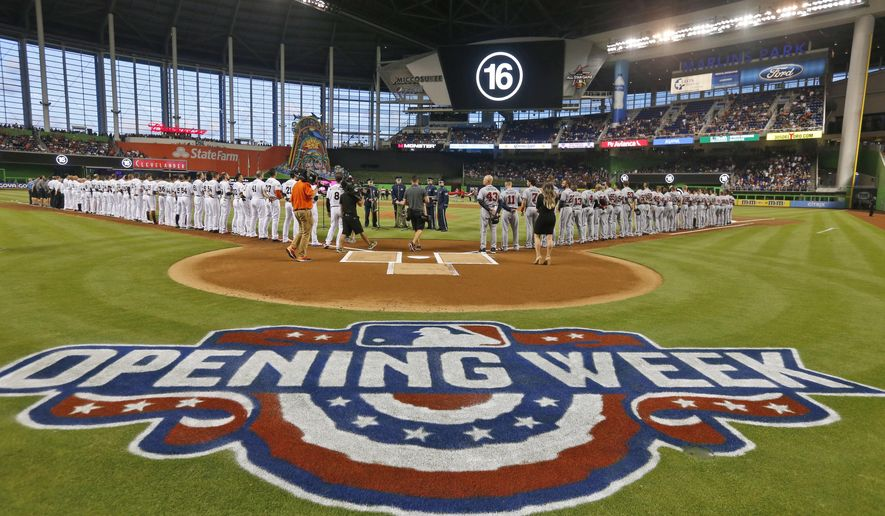 Miami Marlins and Atlanta Braves players pause before the start of a baseball game to honor the memory of Marlins pitcher Jose Fernandez  who was killed in a boating accident last year, Tuesday, April 11, 2017, in Miami. (AP Photo/Wilfredo Lee)