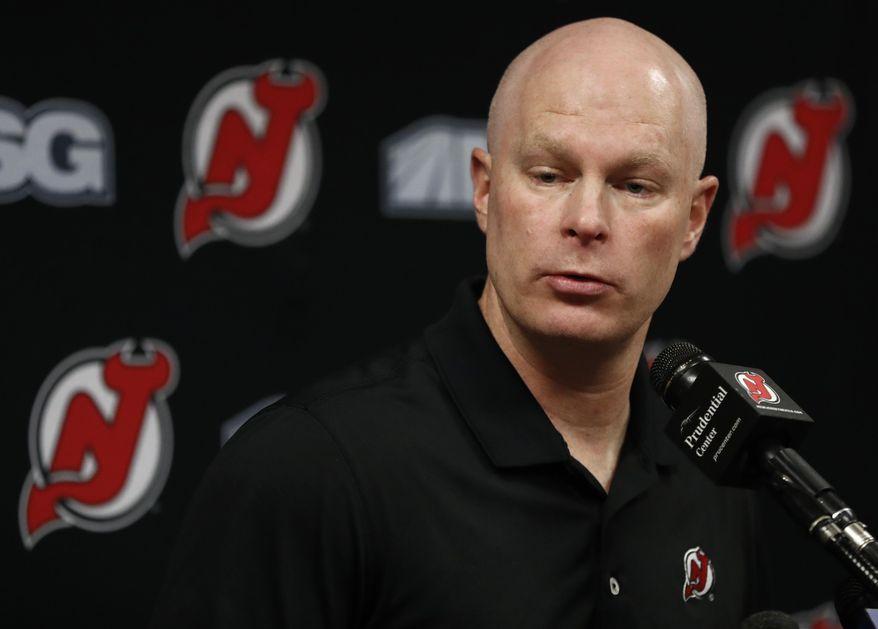 New Jersey Devils head coach John Hynes talks to reporters about the team's NHL hockey season, Tuesday, April 11, 2017, in Newark, N.J. (AP Photo/Julio Cortez)