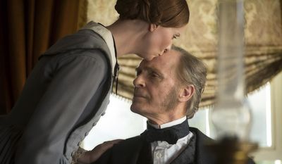 """This image released by Music Box Films shows Cynthia Nixon, left, and Keith Carradine in a scene from, """"A Quiet Passion."""" (Johan Voets/Music Box Films via AP)"""