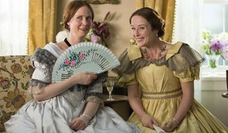 """This image released by Music Box Films shows Cynthia Nixon, left, and Jennifer Ehle in a scene from, """"A Quiet Passion."""" (Johan Voets/Music Box Films via AP)"""