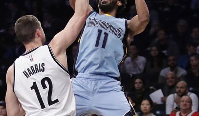 FILE - In this Feb. 13, 2017, file photo, Memphis Grizzlies' Mike Conley (11) shoots over Brooklyn Nets' Joe Harris (12) during the first half of an NBA basketball game, in New York. Aside from his deep pockets due to that $153 million contract, Conley has been largely overlooked on the NBA landscape but has led Memphis back to the postseason yet again.(AP Photo/Frank Franklin II, FIle)