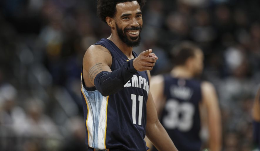 FILE - In this Feb. 26, 2017, file photo, Memphis Grizzlies guard Mike Conley smiles as he gestures to the bench after hitting a key basket to pull ahead of the Denver Nuggets late in the second half of an NBA basketball game, in Denver. Conley cashed in during free agency then he paid dividends for the Grizzlies once the season tipped off. A healthy Conley has been impressive with his best year yet.  (AP Photo/David Zalubowski, File)