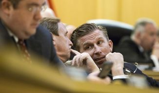 House Republican Caucus Chairman Ryan Williams of Cookeville, right, confers with Rep. Mike Carter, R-Chattanooga, during a House Transportation Committee meeting in Nashville, Tenn., on Tuesday, April 11, 2017. The panel was taking up Gov. Bill Haslam's proposal to boost transportation funding in Tennessee. (AP Photo/Erik Schelzig)