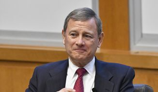 In this Feb. 1, 2017, file photo, U.S. Supreme Court Chief Justice John Roberts prepares to speak at the The John G. Heyburn II Initiative and University of Kentucky College of Law's judicial conference and speaker series in Lexington, Ky. (AP Photo/Timothy D. Easley, File)