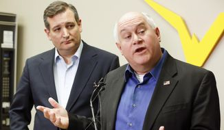 Kansas 4th District congressional candidate Ron Estes, right, and Sen. Ted Cruz who came to Wichita to campaign for Estes the day before a special election speak to the media during a news conference before their rally at Yingling Aviation, Monday, April 10, 2017, in Wichita, Kan. (Fernando Salazar/The Wichita Eagle via AP)