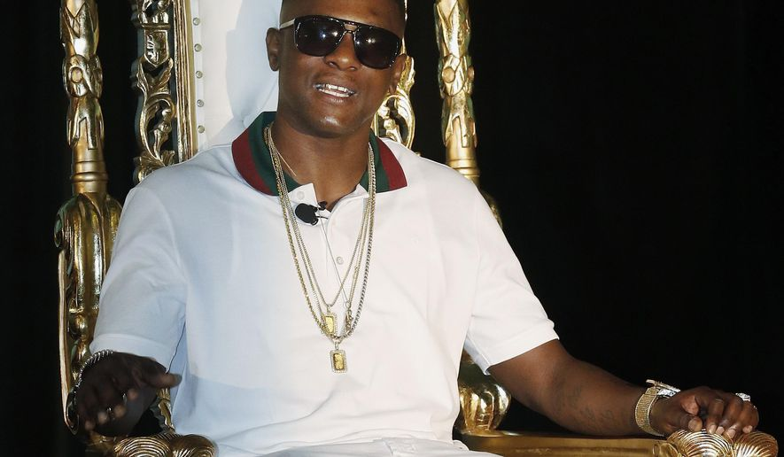 FILE - In this March 10, 2014 file photo, rapper Lil Boosie, whose real name is Torence Hatch, appears at a news conference in New Orleans. A Mississippi police department denies that officers took Boosie's jewelry. Boosie Badazz, formerly known as Lil Boosie, says in a Tuesday, April 11, 2017, video that Biloxi police seized a bag of jewelry on Sunday when they arrested several members of his entourage for assault. (AP Photo/Bill Haber, File)