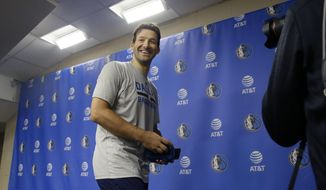 Former Dallas Cowboys quarterback Tony Romo smiles as he leaves a news conference after an NBA basketball shoot around in Dallas, Tuesday, April 11, 2017. Romo will be a Maverick for day and ride the bench during a home finale game featuring two teams that failed to make the playoffs this year. (AP Photo/LM Otero)