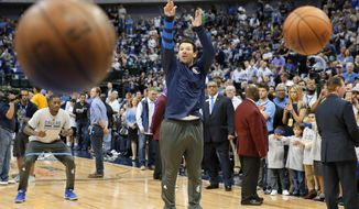 Former Dallas Cowboys quarterback Tony Romo takes a shot during warm ups before an NBA basketball game between the Denver Nuggets and Dallas Mavericks in Dallas, Tuesday, April 11, 2017. (AP Photo/Tony Gutierrez)