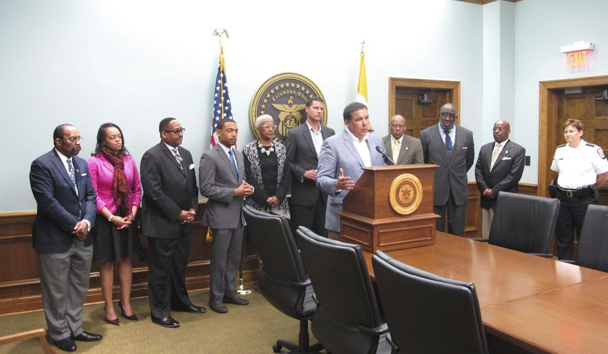 Columbus, Ohio, Mayor Andrew Ginther, front center, joined by city officials and council members including Columbus Division of Police Chief Kim Jacobs, far right, expresses his concern  Tuesday, April 11, 2017, news conference in Columbus, Ohio, over a police officer captured on video apparently kicking a handcuffed suspect in the head, du, Jacobs said Tuesday she's fast-tracking an investigation into the case, with a report expected within two weeks. (AP Photo/Andrew Welsh-Huggins)