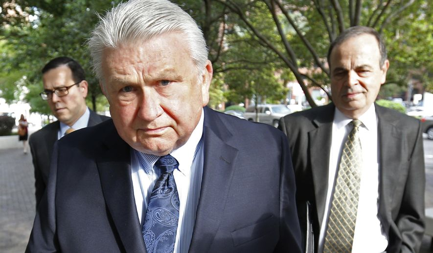 FILE - In this April 20, 2016, file photo, Harry Morel, a former district attorney for St. Charles Parish, La., arrives with his attorney Ralph Capitelli, right, at federal court in New Orleans. Morel, accused of extorting sexual favors from more than 20 women in exchange for favorable treatment from his office, is being sued by the mother of Danelle Keim, one of his alleged victims. The racketeering lawsuit was filed in state court Monday, April 10, 2017. (AP Photo/Gerald Herbert, File)