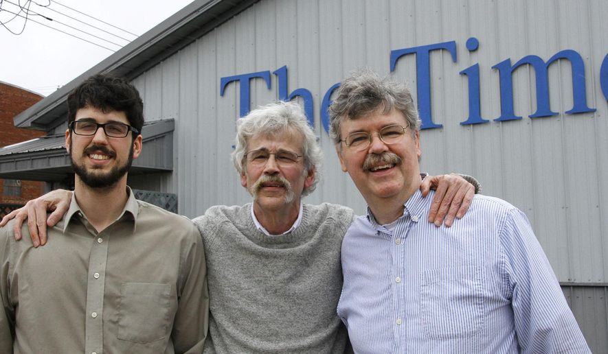 "In this Monday, April 10, 2017, photo provided by the Storm Lake Times, Art Cullen, center, editor and co-owner of the small-town newspaper, poses for a photo with his son, Tom, left, and brother, John, outside the paper in Storm Lake, Iowa, after Art won the Pulitzer Prize for editorial writing. Cullen's writing took on powerful agricultural groups for allowing nitrogen runoff to pollute lakes and streams and wrote that the state ""has the dirtiest surface water in America."" (Dolores Cullen/Storm Lake Times via AP)"