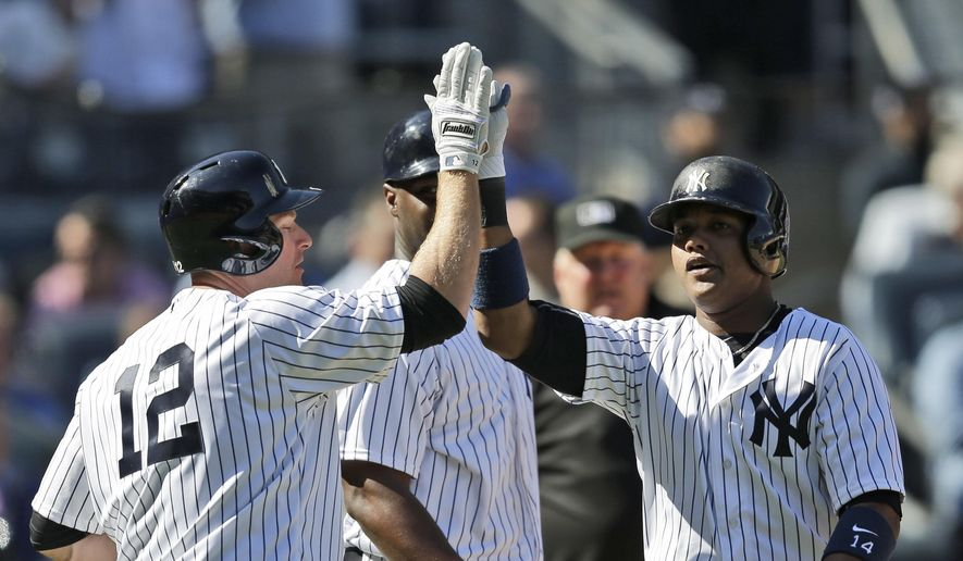 New York Yankees' Starlin Castro, right, celebrates his two-run homer with Chase Headley during the eighth inning of the baseball game against the Tampa Bay Rays at Yankee Stadium, Monday, April 10, 2017, in New York. The Yankees defeated the Rays 8-1. (AP Photo/Seth Wenig)