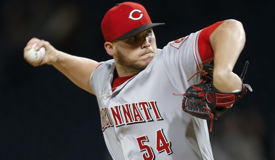 Cincinnati Reds starter Rookie Davis pitches against the Pittsburgh Pirates during the first inning of a baseball game, Tuesday, April 11, 2017, in Pittsburgh. (AP Photo/Keith Srakocic)