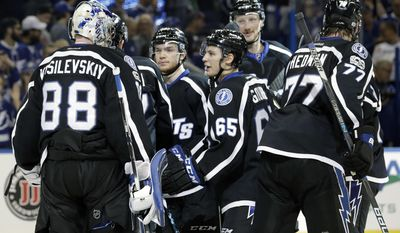 Tampa Bay Lightning goalie Andrei Vasilevskiy (88) celebrates with teammates after the team defeated the Buffalo Sabres 4-2 during an NHL hockey game, Sunday, April 9, 2017, in Tampa, Fla. (AP Photo/Chris O'Meara)