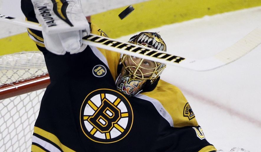 Boston Bruins goalie Tuukka Rask makes a stick save during the first period of the team's NHL hockey game Ottawa Senators, Thursday, April 6, 2017, in Boston. (AP Photo/Elise Amendola)