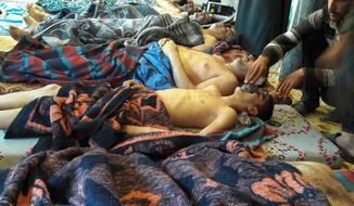 FILE -- In this Tuesday, April 4, 2017 file photo, victims of the suspected chemical weapons attack lie on the ground, in Khan Sheikhoun, in the northern province of Idlib, Syria. Turkey's health minister, Recep Akdag said Tuesday, April 11, 2017, that test results conducted on victims of the chemical attack in Khan Sheikhoun confirm that sarin gas was used. Officials from the World Health Organization and the Organization for the Prohibition of Chemical Weapons participated in the autopsies. (Alaa Alyousef via AP, File)