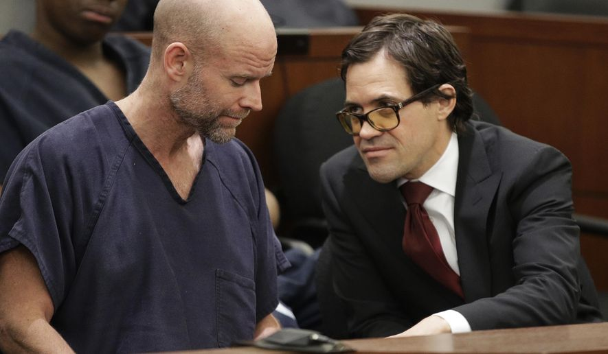 Nicolai Howard Mork, left, speaks with attorney Nicholas Wooldridge in court Tuesday, April 11, 2017, in Las Vegas. Mork plead not guilty Tuesday to terrorism and possession of weapons of mass destruction, explosives and firearms charges following his indictment last week in Nevada state court. (AP Photo/John Locher)
