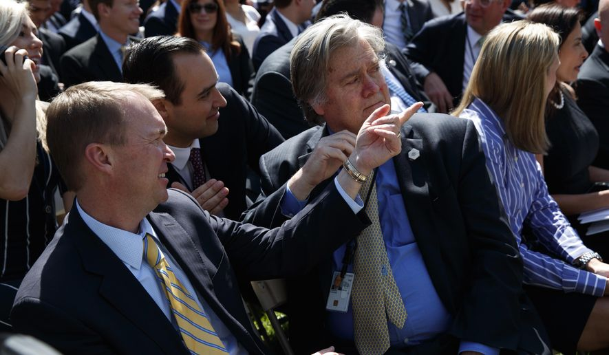 Budget Director Mick Mulvaney, left, talks with White House chief strategist Steve Bannon before the start of a public swearing ceremony for new Supreme Court Justice Neil Gorsuch, in the Rose Garden of the White House in Washington, Monday, April 10, 2017. (AP Photo/Evan Vucci)