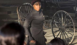 "In this image released by WGN America, Aisha Hinds portrays Harriet Tubman in a scene from ""Underground."" (Kim Simms/WGN America via AP)"