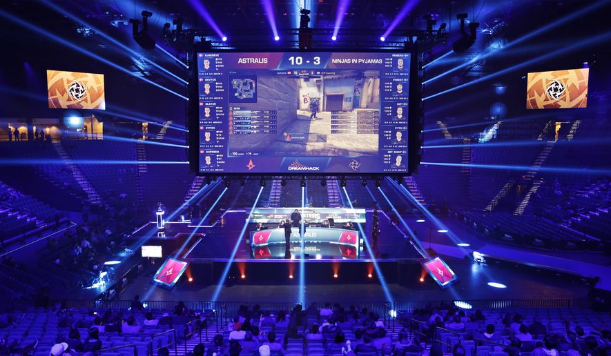 File - In this Feb. 18, 2017, file photo, teams compete against each other during the Dreamhack Masters e-sports tournament at the MGM Grand Garden Arena in Las Vegas. The Las Vegas Strip is getting its first space dedicated for competitive gaming when the Luxor hotel-casino transforms its nightclub into a multi-level e-sports arena. MGM Resorts International on Tuesday said the venue is expected to open in early 2018. (AP Photo/John Locher, File)
