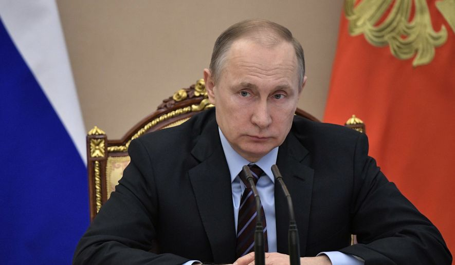 Russian President Vladimir Putin heads the Cabinet meeting in Moscow, Russia, Wednesday, April 12, 2017. (Alexei Nikolsky/Sputnik, Kremlin Pool Photo via AP)