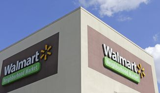 This Wednesday, Feb. 8, 2017, photo shows Wal-Mart signage at one of the company's neighborhood markets, in Hialeah, Fla. Starting April 19, 2017, Wal-Mart says it will offer discounts on thousands of online-only items when customers elect to have them shipped to one of the company's stores for pickup. (AP Photo/Alan Diaz)