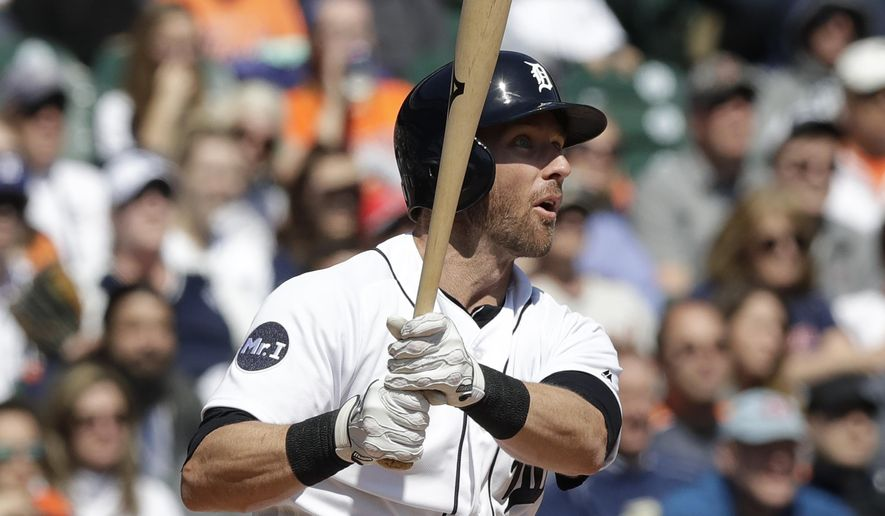 Detroit Tigers' Andrew Romine follows through on his grand slam during the fourth inning of a baseball game against the Minnesota Twins, Wednesday, April 12, 2017, in Detroit. (AP Photo/Carlos Osorio)