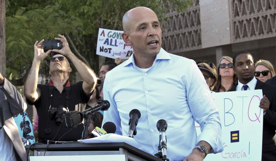 Democrat David Garcia announces his run for Arizona governor at the state Capitol in Phoenix, on April 12, 2017. Garcia plans to take on Republican Gov. Doug Ducey if he wins his party's nomination and is attacking Ducey for signing a school voucher law that critics say will drain money from public schools. (AP Photo/Bob Christie)
