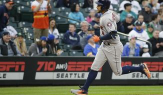 Houston Astros' George Springer rounds the bases after hitting a solo home run during the first inning of the team's baseball game against the Seattle Mariners, Tuesday, April 11, 2017, in Seattle. (AP Photo/Ted S. Warren)