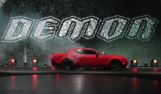 The 2018 Dodge Challenger SRT Demon is unveiled during a media preview for the New York International Auto Show, Tuesday, April 11, 2017, in New York. (AP Photo/Julie Jacobson)