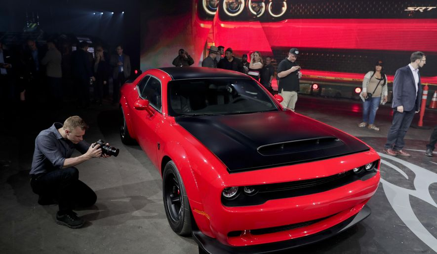 The 2018 Dodge Challenger SRT Demon sits on display during a media preview for the New York International Auto Show, Tuesday, April 11, 2017, in New York. (AP Photo/Julie Jacobson)