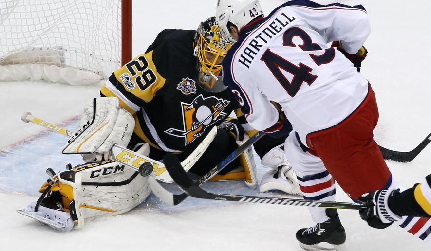 Pittsburgh Penguins goalie Marc-Andre Fleury (29) stops a shot by Columbus Blue Jackets' Scott Hartnell (43) during the first period of Game 1 of an NHL first-round hockey playoff series in Pittsburgh, Wednesday, April 12, 2017. (AP Photo/Gene J. Puskar)