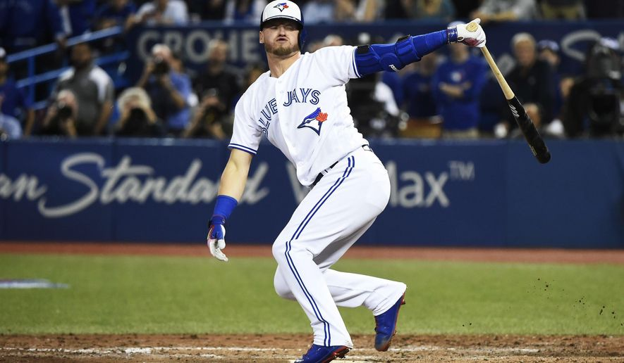 Toronto Blue Jays' Josh Donaldson strikes out against the Milwaukee Brewers during the ninth inning of a baseball game against the Milwaukee Brewers in Toronto on Tuesday, April 11, 2017. (Nathan Dennette/The Canadian Press via AP)