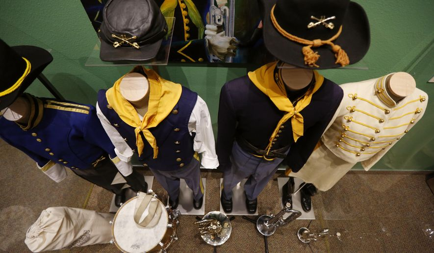 In a Tuesday, April 4, 2017 photo, a selection of Troopers Drum & Bugle Corps uniforms from years past are included in an exhibit  at Fort Caspar Museum in Casper, Wyo. (Alan Rogers/The Casper Star-Tribune via AP)