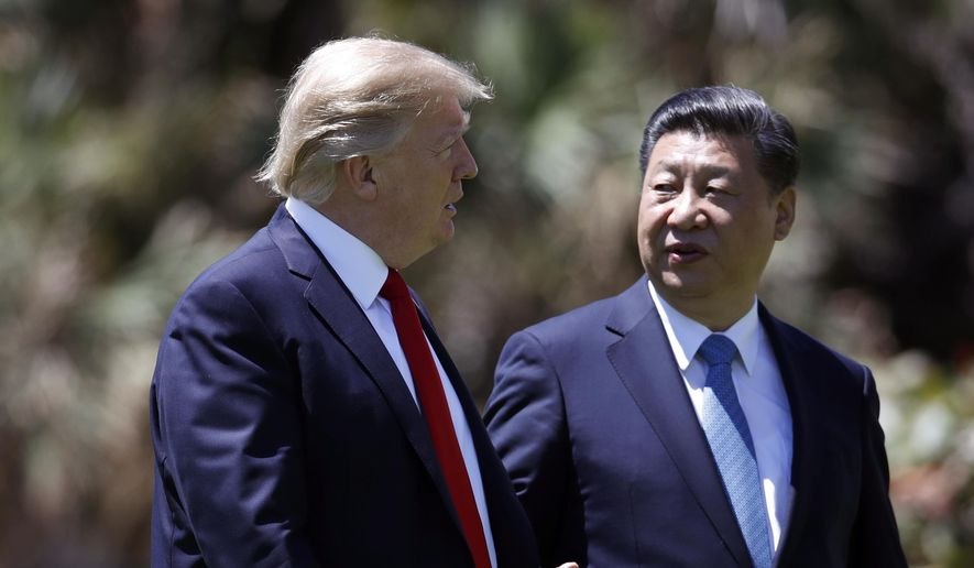 President Donald Trump, left, and Chinese President Xi Jinping walk together after their meetings at Mar-a-Lago, in Palm Beach, Fla., in this April 7, 2017, file photo. (AP Photo/Alex Brandon, File)