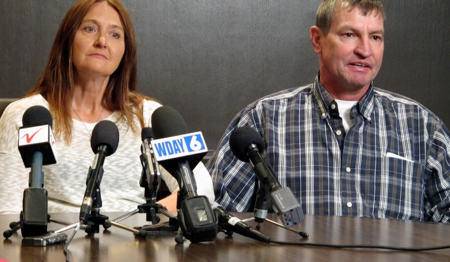 "FILE - In this April 15, 2016, file photo, Tammy and John Sadek, parents of Andrew Sadek, a North Dakota college student who was a confidential informant for a drug task force before he turned up dead, talk about the case at a news conference in Fargo, N.D. Almost three years after Andrew's death, the North Dakota Legislature is putting the final touches on a bill aimed at better protecting confidential drug informants. The bill called ""Andrew's Law"" comes after his parents lobbied lawmakers to pass legislation which clarifies the rights of people offered the role. (AP Photo/Dave Kolpack, File)"