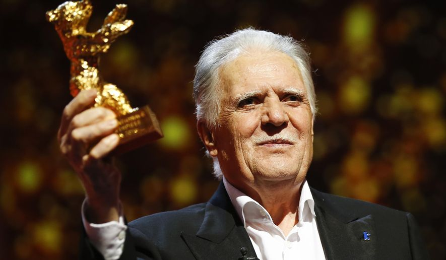 FILE - In this Feb. 18, 2016 file photo German cinematographer Michael Ballhaus shows the Honorary Golden Bear after being awarded for his lifetime achievement during the awarding ceremony at the 2016 Berlinale Film Festival in Berlin, Germany. Ballhaus has died. He was 81. (AP Photo/Axel Schmidt, file)