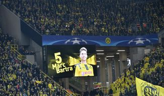 Dortmund's Marc Bartra who was injured in an explosion the day before appears on a screen prior to the Champions League quarterfinal first leg soccer match between Borussia Dortmund and AS Monaco in Dortmund, Germany, Wednesday, April 12, 2017. (AP Photo/Martin Meissner)