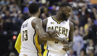 Indiana Pacers' Paul George and Lance Stephenson react during the second half of the team's NBA basketball game against the Atlanta Hawks, Wednesday, April 12, 2017, in Indianapolis. Indiana defeated Atlanta 104-86. (AP Photo/Darron Cummings)