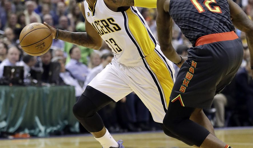 Indiana Pacers' Paul George goes to the basket against Atlanta Hawks' Taurean Prince during the first half of an NBA basketball game Wednesday, April 12, 2017, in Indianapolis. (AP Photo/Darron Cummings)