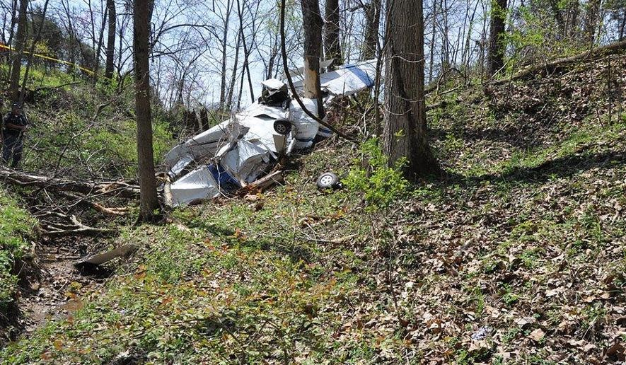 In this photo provided by the Bartholomew County Sheriff's Department, it shows a small plane that crashed Wednesday, April 12, 2017 in Hartsville, Ind. The pilot was killed in the crash. (Bartholomew Sheriff's Department via AP)