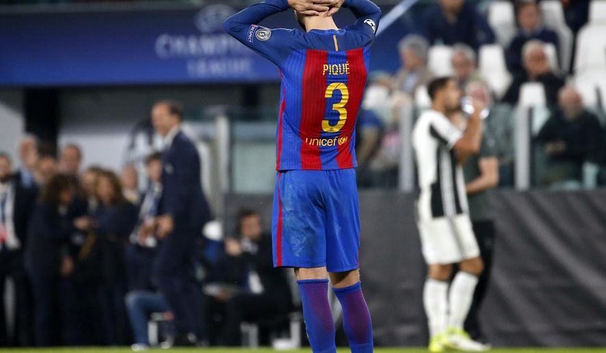 Barcelona's Gerard Pique holds his head at the end of a Champions League, quarterfinal, first-leg soccer match between Juventus and Barcelona, at the Juventus Stadium in Turin, Italy, Tuesday, April 11, 2017. Juventus won 3-0. (AP Photo/Antonio Calanni)