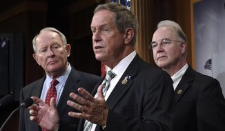 "FILE- In this July 27, 2015, file photo, Rep. Joe Wilson, R-S.C., center, speaks during a news conference on Capitol Hill in Washington. The South Carolina representative who shouted ""You Lie"" at President Barack Obama during a joint session of Congress was on the receiving end of the same words in his district this week. Wilson heard plenty of boos and chants of ""You Lie"" during a town hall Monday, April 10, 2017, in Graniteville, S.C. (AP Photo/Susan Walsh, File)"