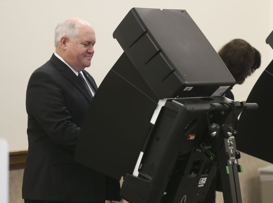GOP congressional candidate in the 4th district Ron Estes votes at Holy Cross Lutheran Church, Tuesday, April 11, 2017, in Wichita, Kan. (Jaime Green/The Wichita Eagle via AP)