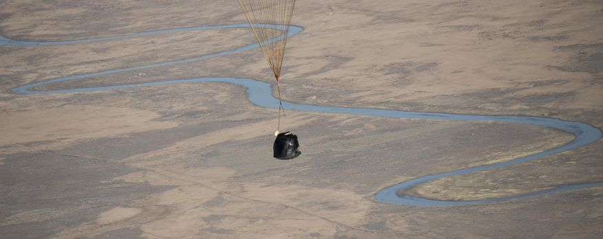The Soyuz MS-02 spacecraft is seen as it lands with Expedition 50 Commander Shane Kimbrough of NASA and Flight Engineers Sergey Ryzhikov and Andrey Borisenko of Roscosmos near Dzhezkazgan, Kazakhstan on Monday, April 10, 2017. Kimbrough, Ryzhikov, and Borisenko returned from the International Space Station. (Bill Ingalls/NASA via AP)