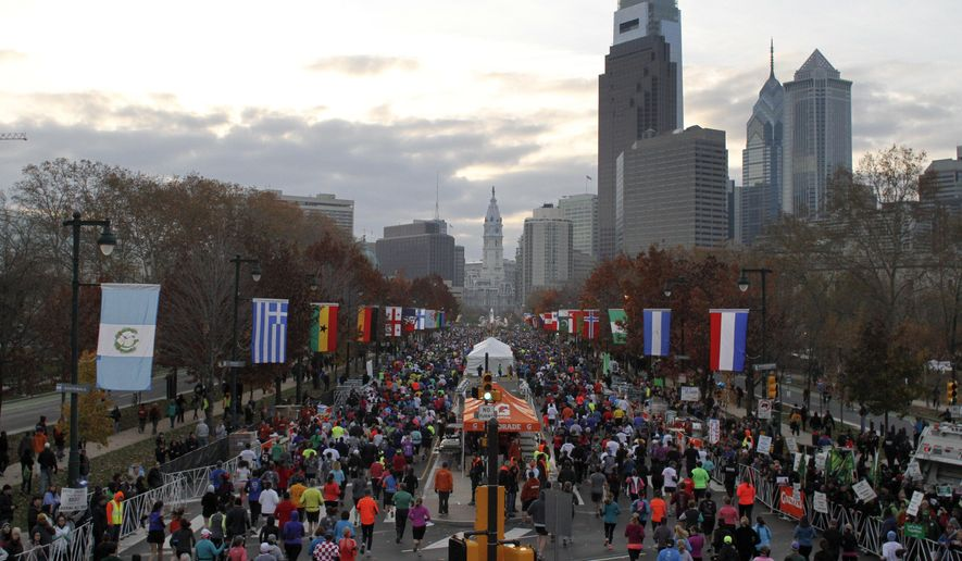 FILE - In this Sunday, Nov. 18, 2012 file photo, runners make their way down Benjamin Franklin Parkway in Philadelphia during the Philadelphia Marathon. A study released on Wednesday, April 12, 2017 shows that marathons can be risky for hearts, but not necessarily those of the runners. It takes longer for nearby residents to get to a hospital for emergency heart care on the day of a race and they're less likely to survive. (AP Photo/ Joseph Kaczmarek)